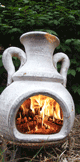 firewood logs burning in a chiminea
